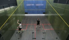 Both players hit cross court drives and straight drops only